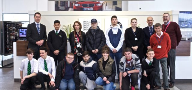 Group of young people including YES Project participants on a work tour on Sytner BMW