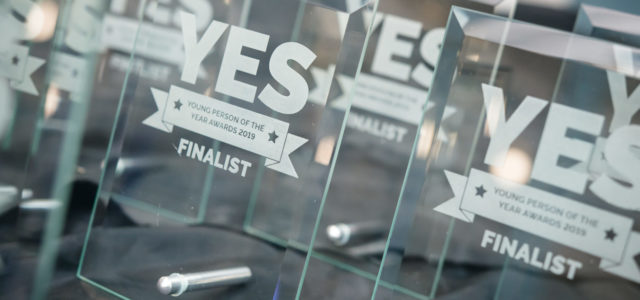 Several glass YES Project Awards for winners