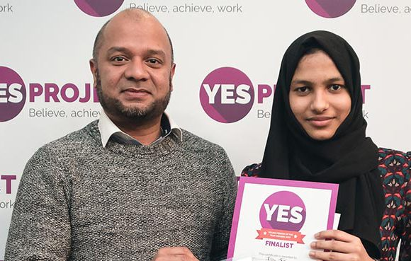 Ilam with keyworker Ebrahim, receiving her award from BYCS